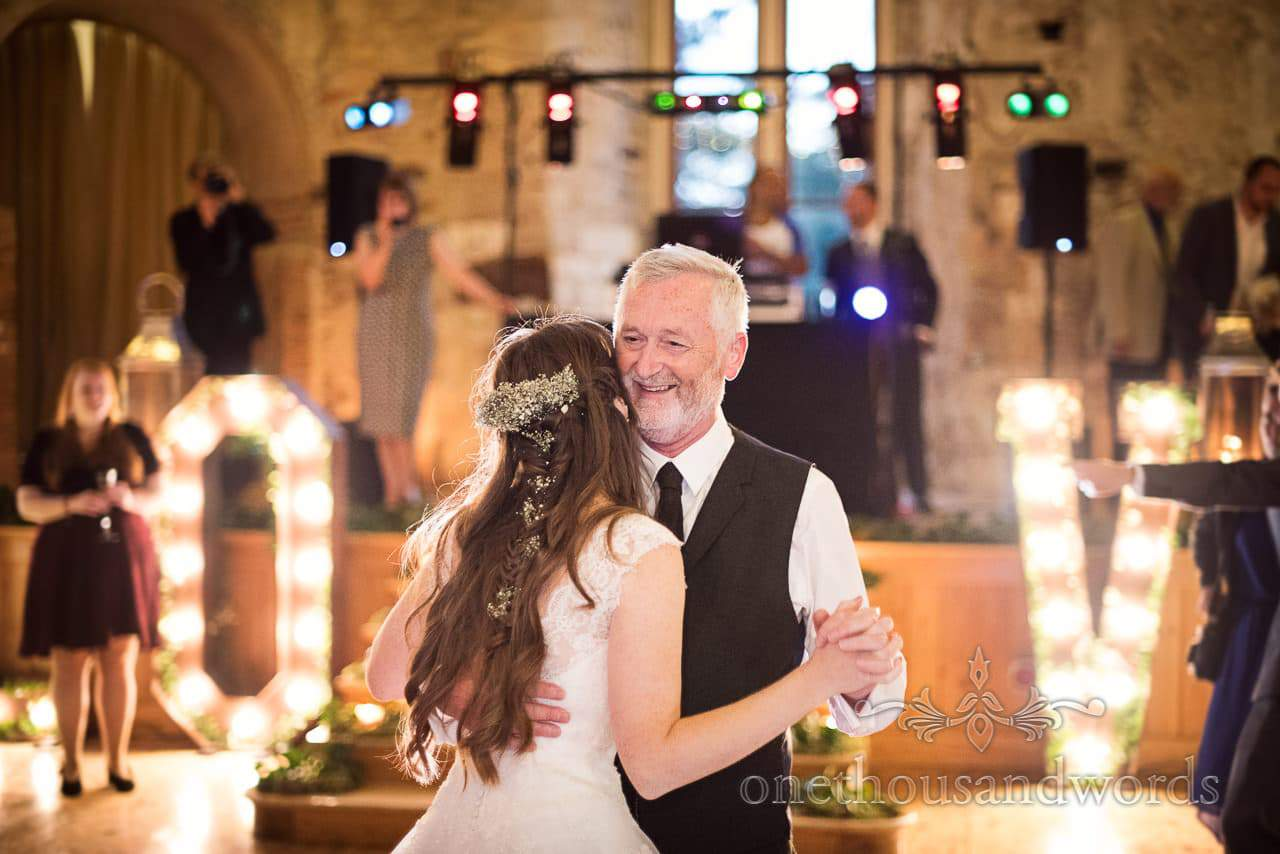 Father of the Bride dance with LOVE letters at Lulworth Castle Wedding