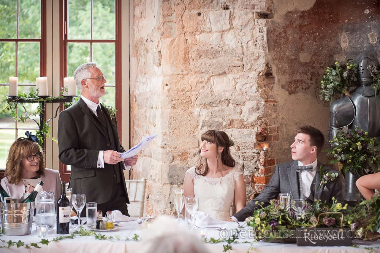 Father of the bride delivers speech at woodland Lulworth Castle wedding