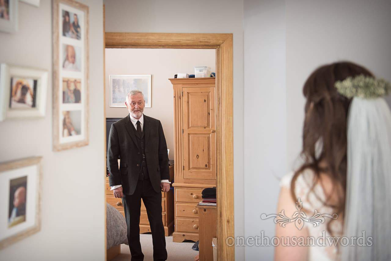 Father of the bride sees bride before woodland Lulworth Castle wedding