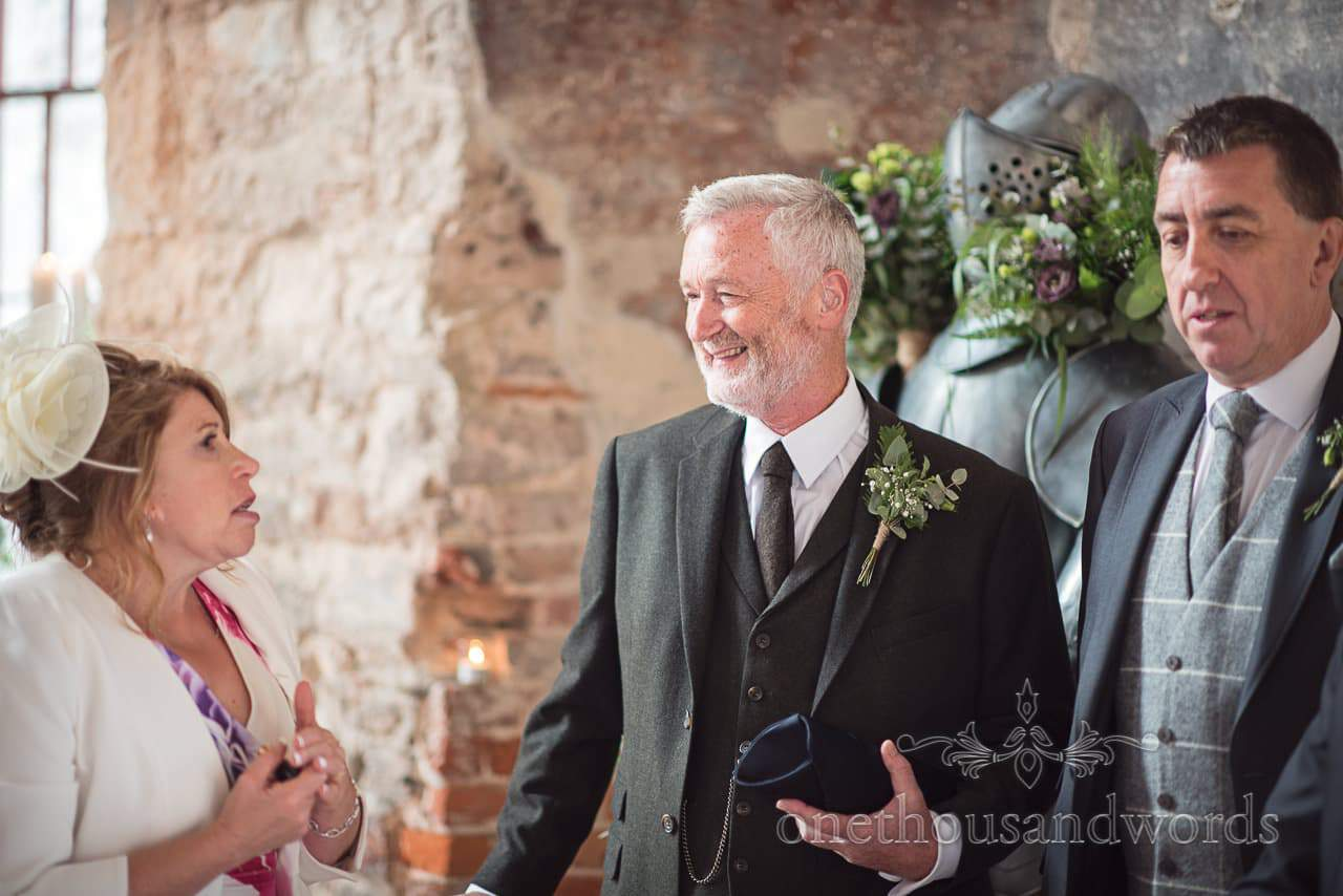 Father of the bride with grooms parents at woodland Lulworth Castle wedding