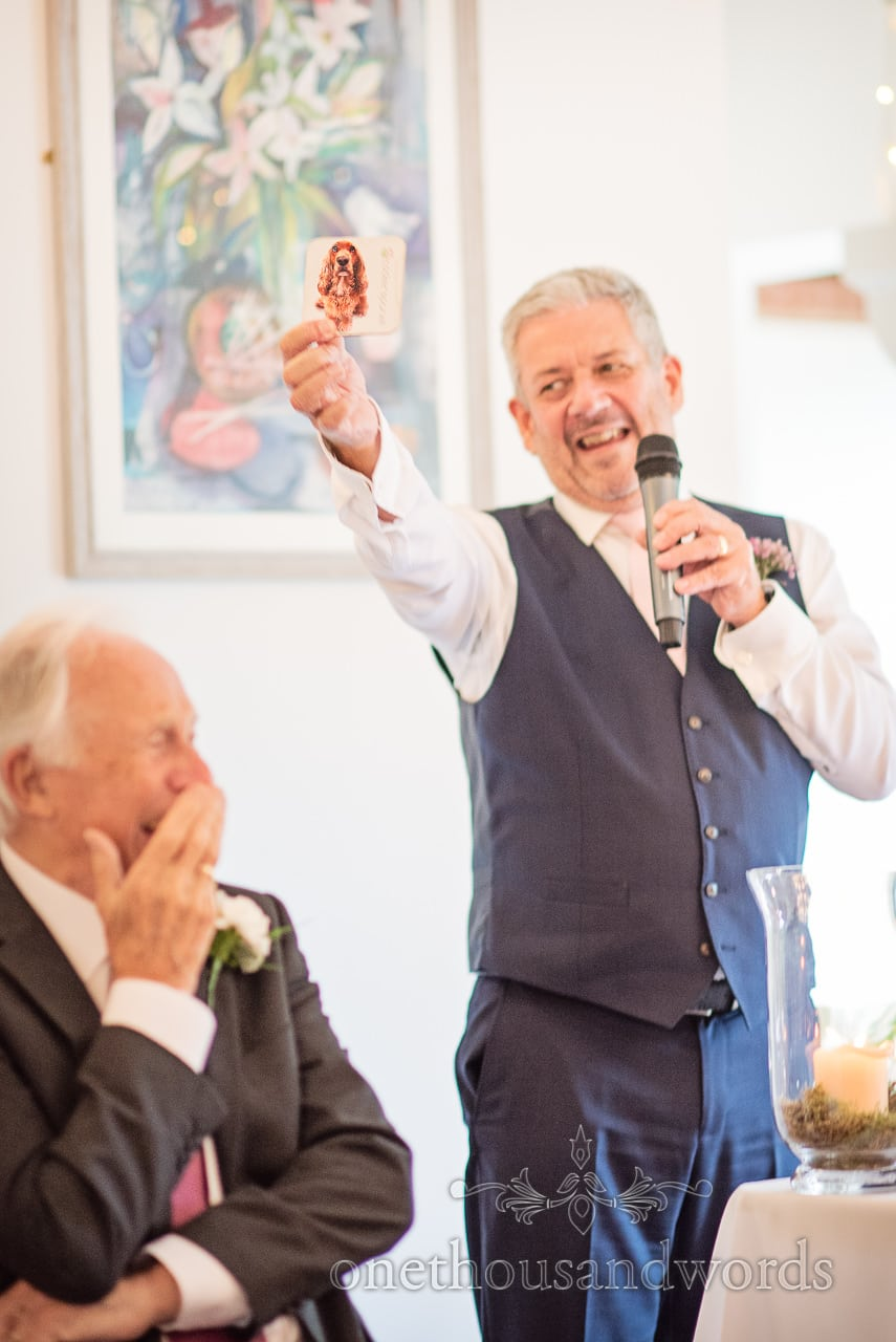 Father of the groom give speech with visual aid at Italian Villa wedding