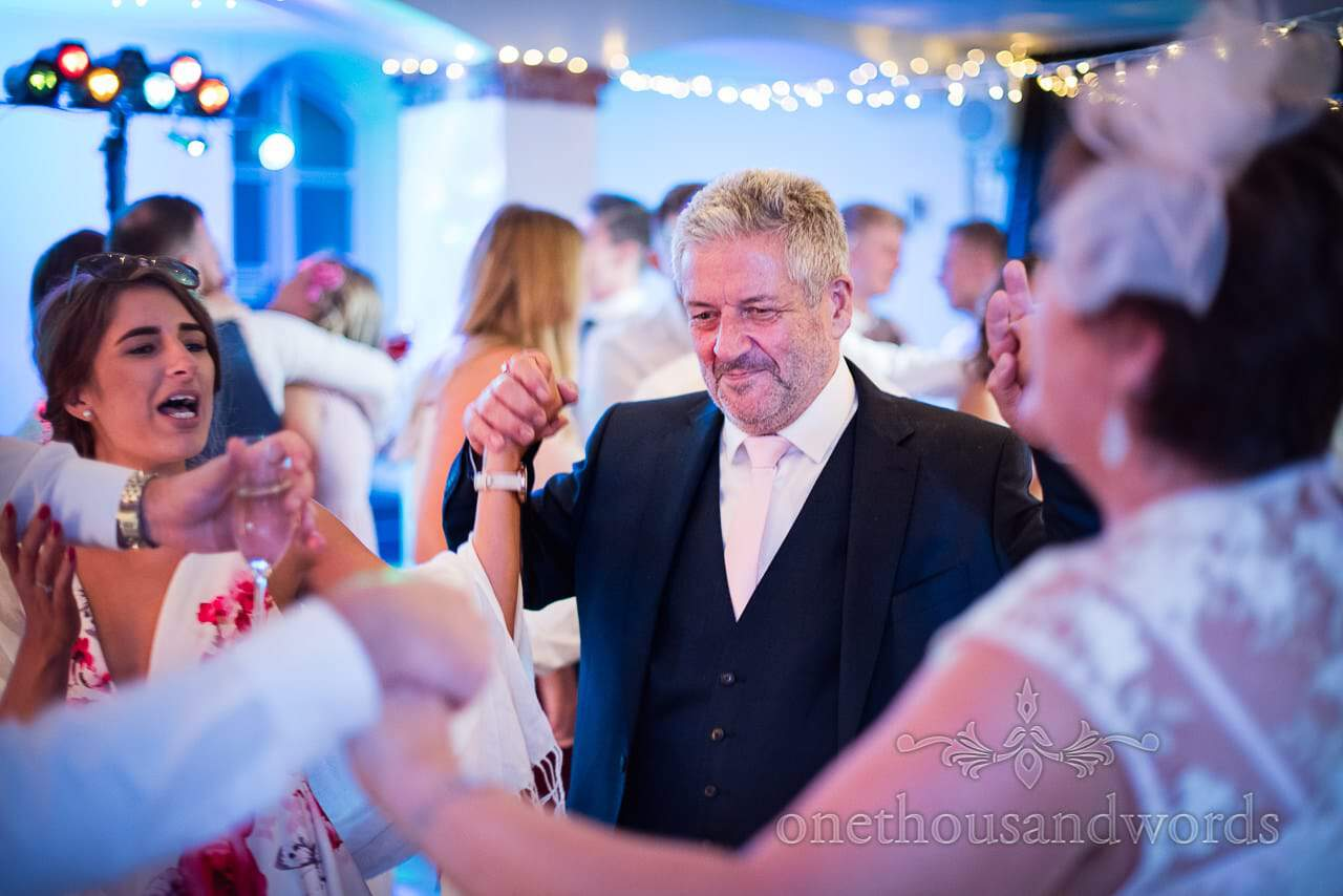 Father of the groom on the dance floor at The Italian Villa Wedding venue in Poole