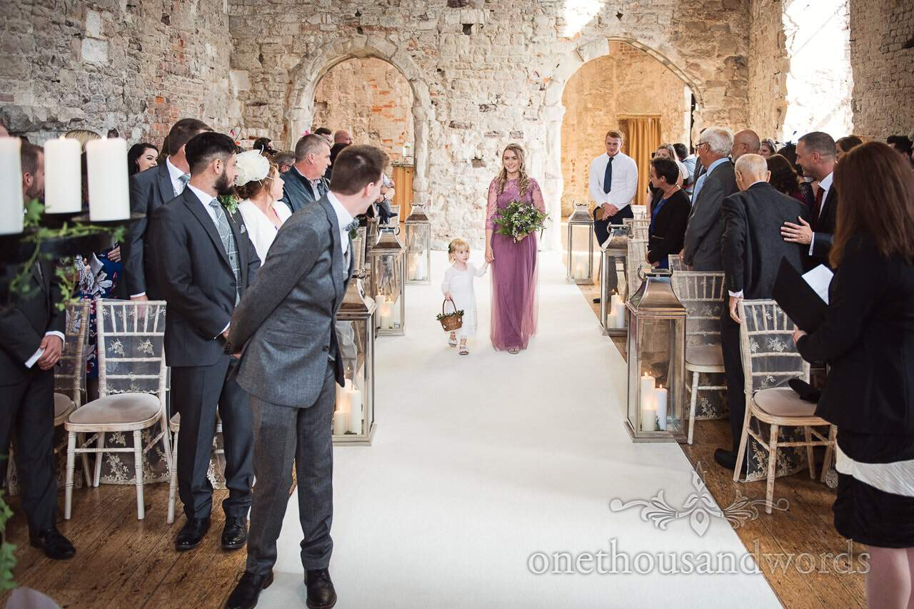 Flower girl and bridesmaid arrive for ceremony at Lulworth castle wedding