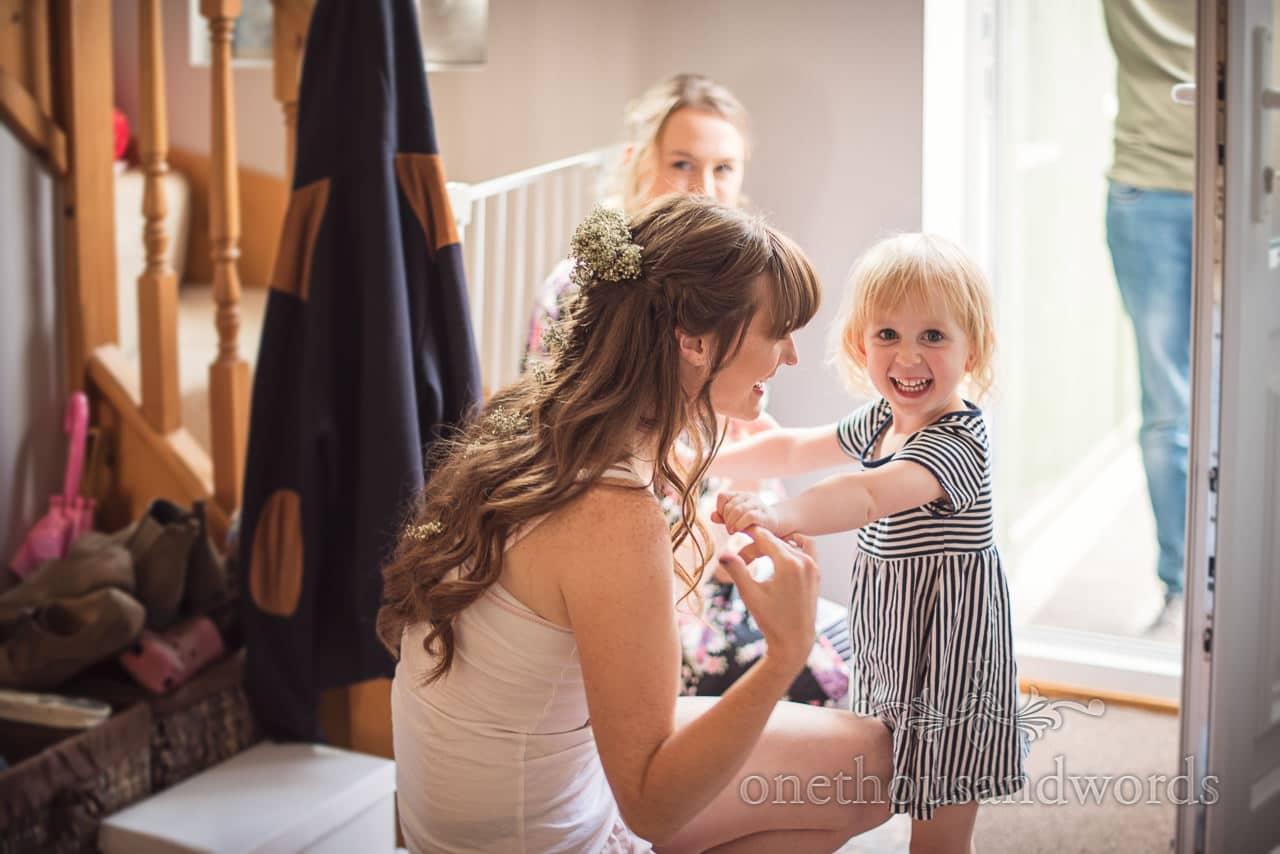 Flower girl arrives on morning of woodland Lulworth Castle wedding