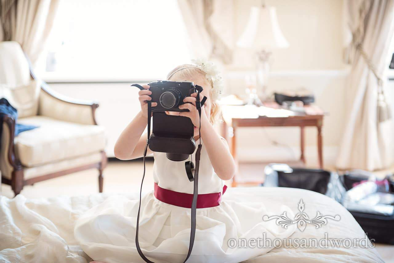 Flower girl takes photographs at Hethfelton House Wedding venue