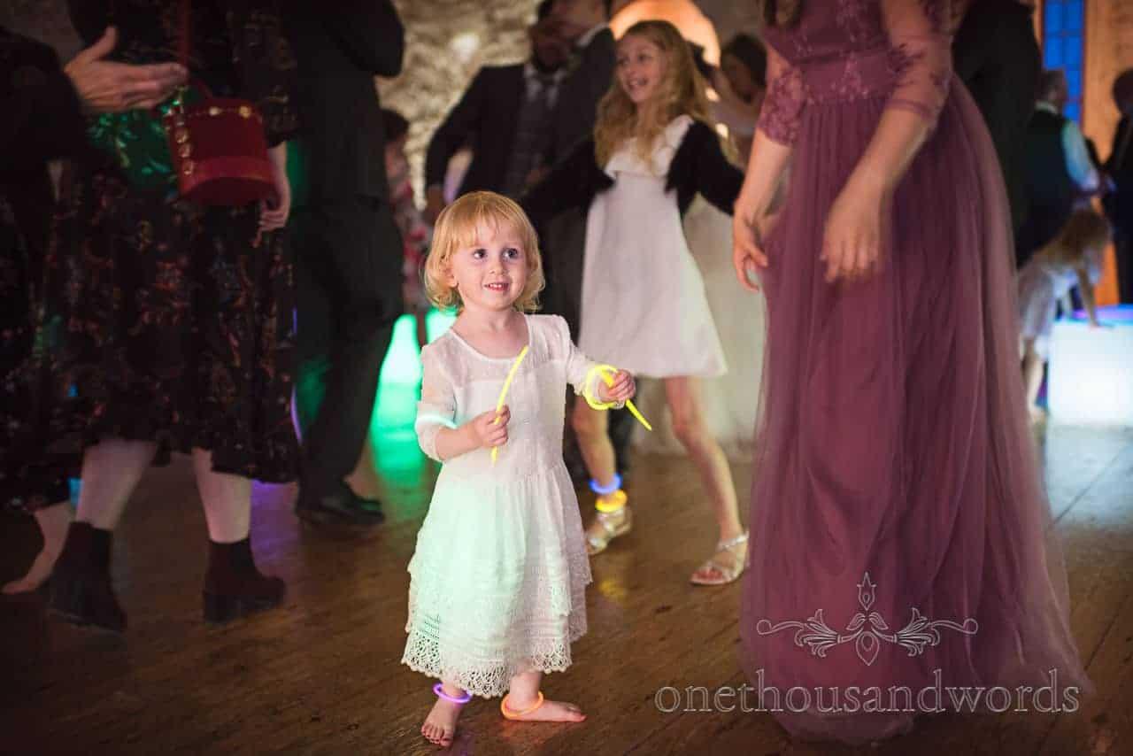 Flower girl with glow sticks on dance floor at Lulworth Castle Wedding