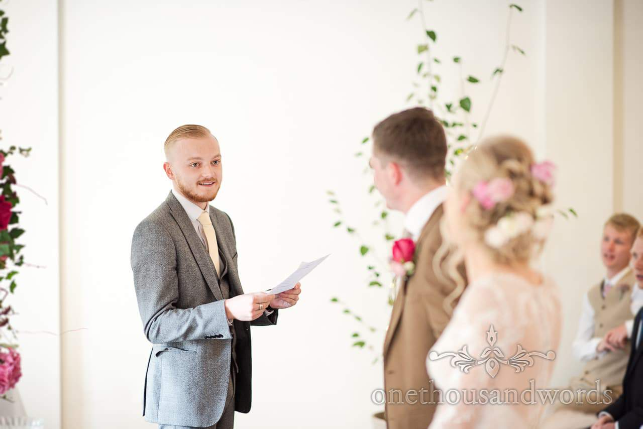 Friend delivers reading during ceremony at Italian Villa documentary wedding photos