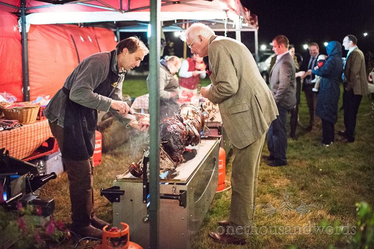 Golden Pig Dorset wedding hog roast serve hot food at farm wedding