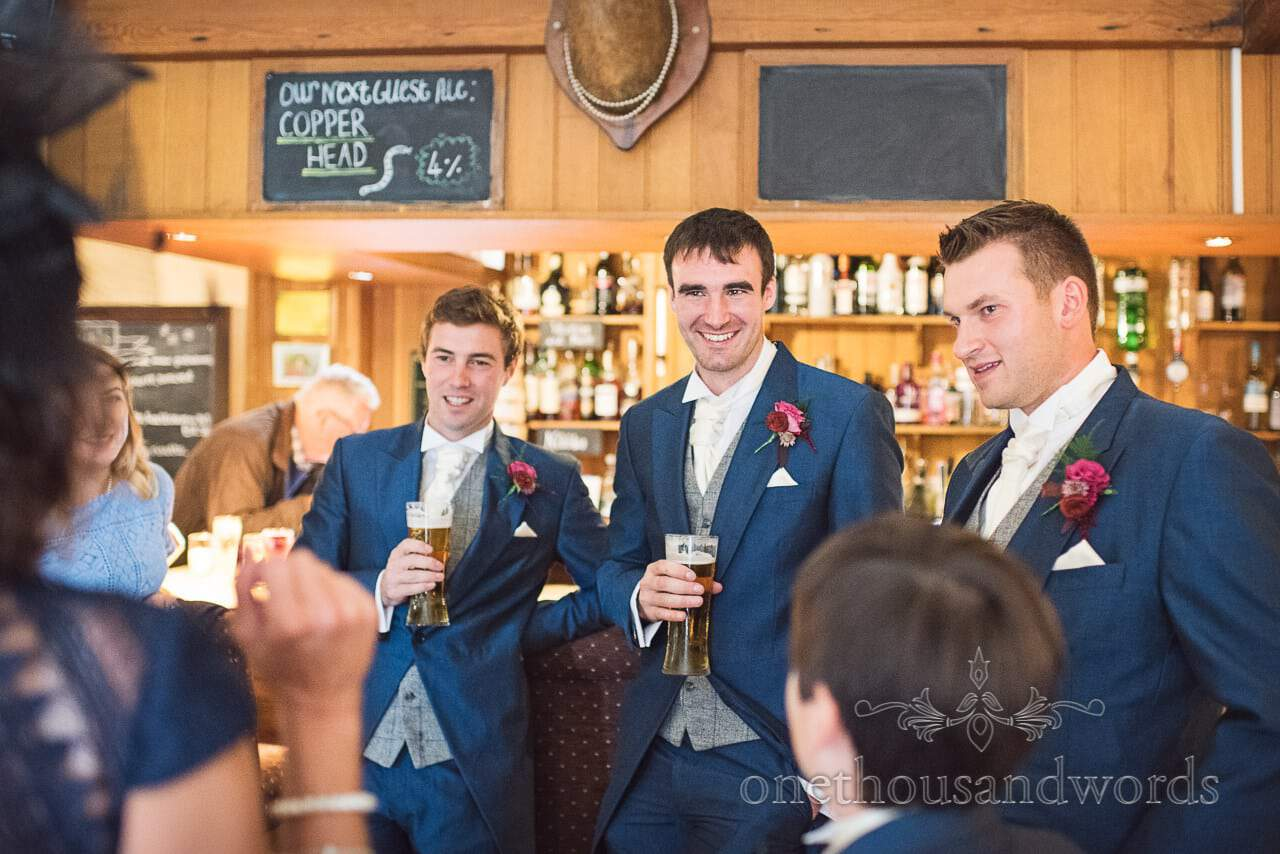Groom and groomsmen enjoy a pint on wedding moring