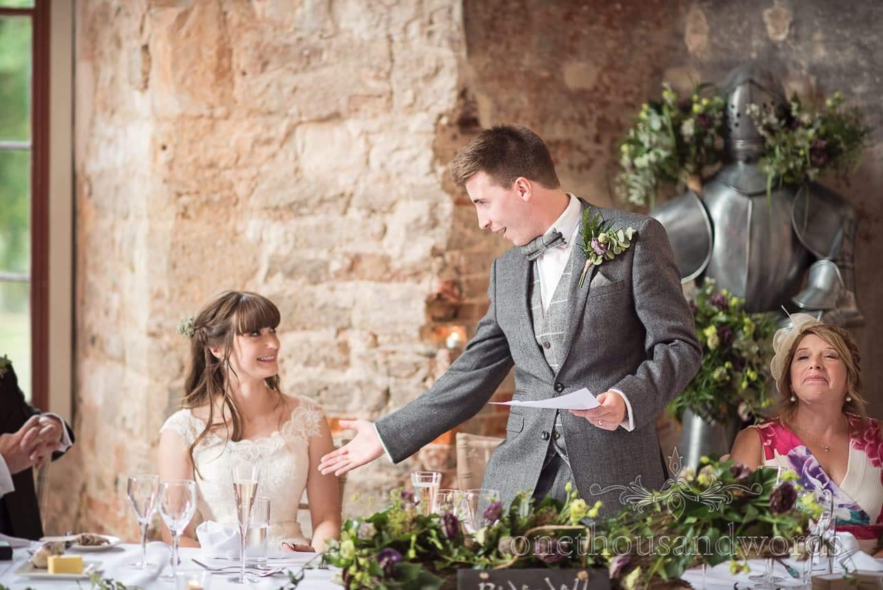 Groom delivers speech at woodland Lulworth Castle wedding