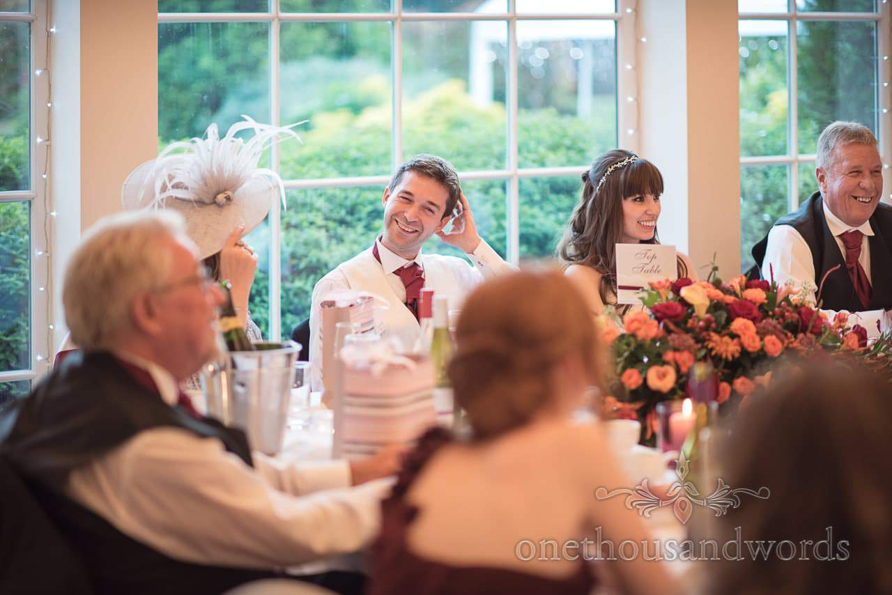 Groom holds his head during best man's speech at Hethfelton House