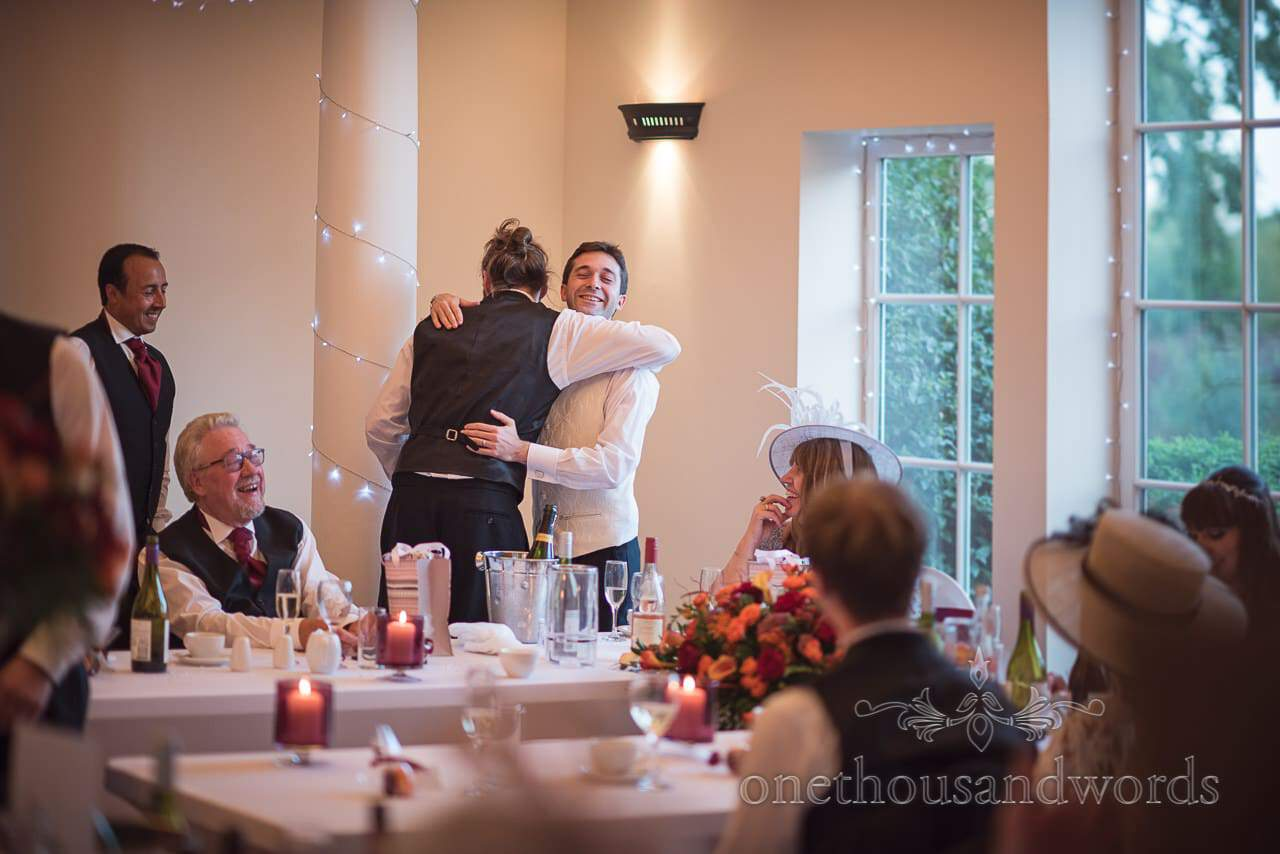 Groom hugs his new brother in law at Hethfelton House Wedding venue