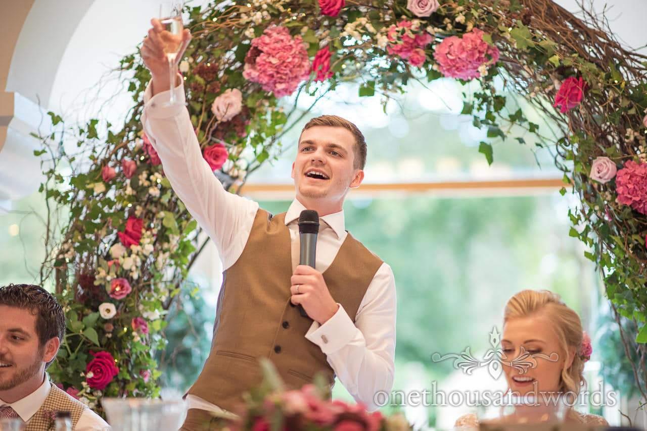Groom raises a toast during speech at Italian Villa wedding