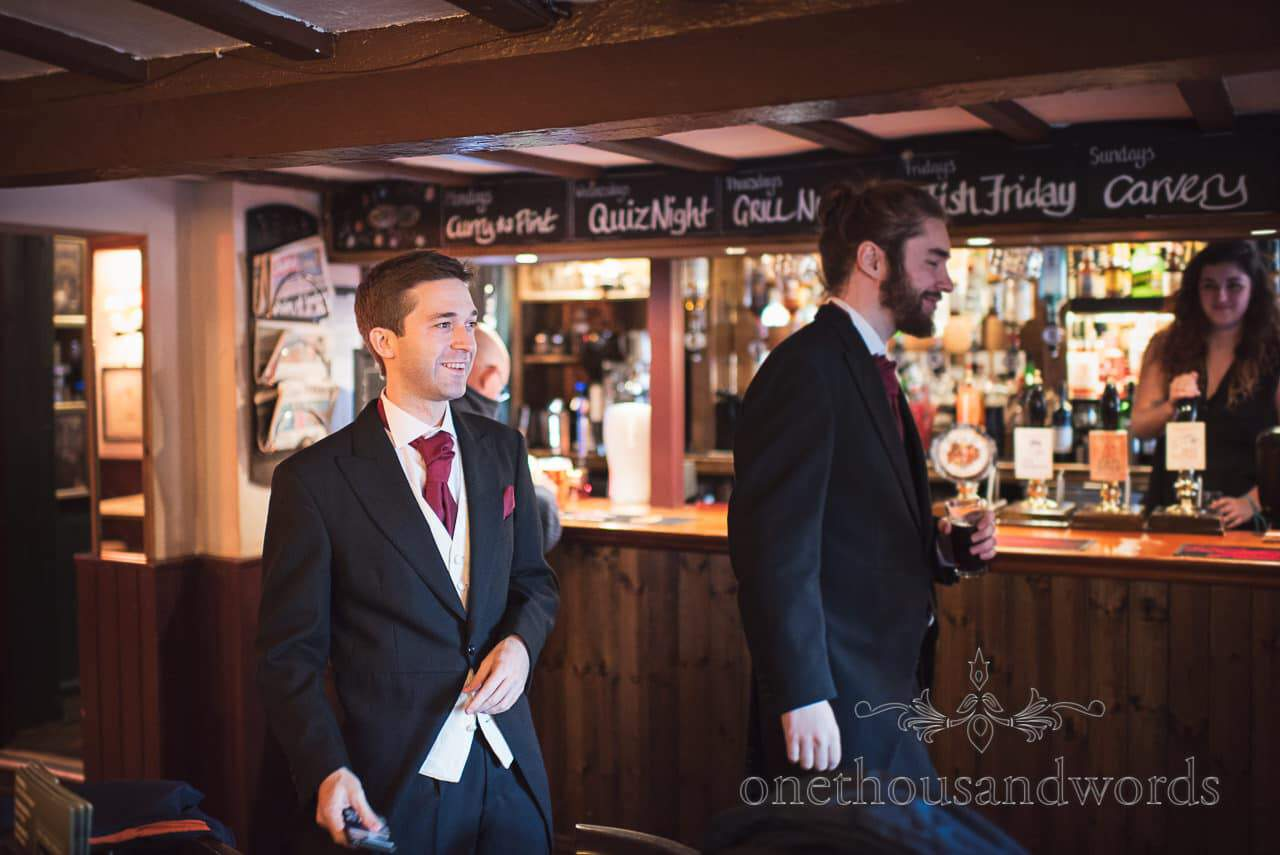 Groom in Traditional English pub on wedding morning in Dorset