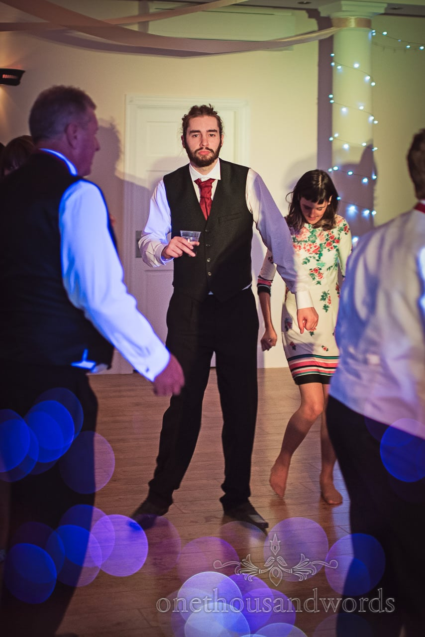 Groom's brother on Wedding dance floor with drink in hand