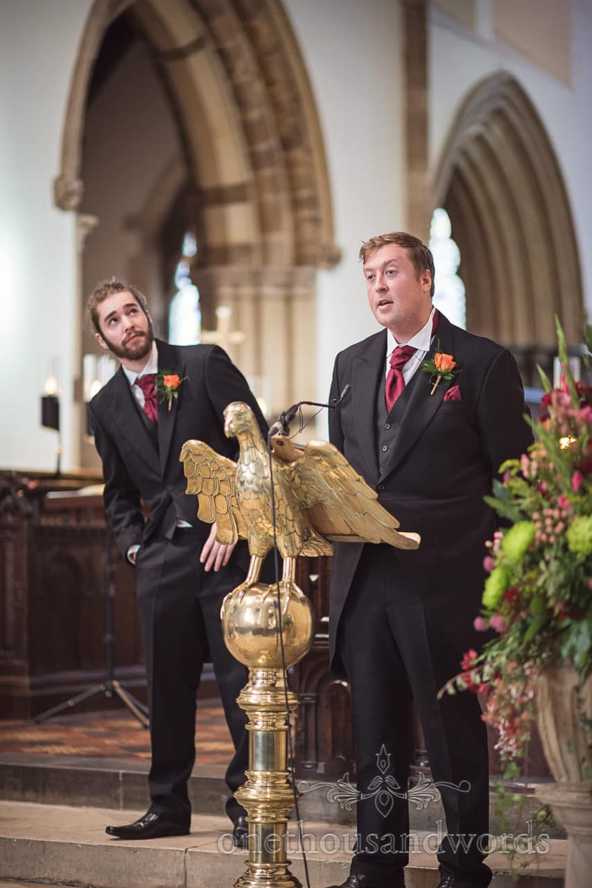 Groomsmans bible reading in Wimborne Minster wedding ceremony