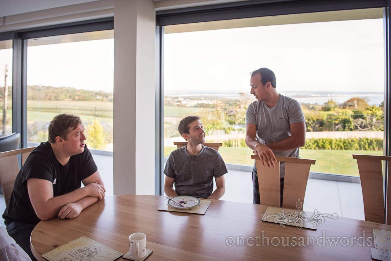 Groomsmen start wedding morning preparations with stunning view