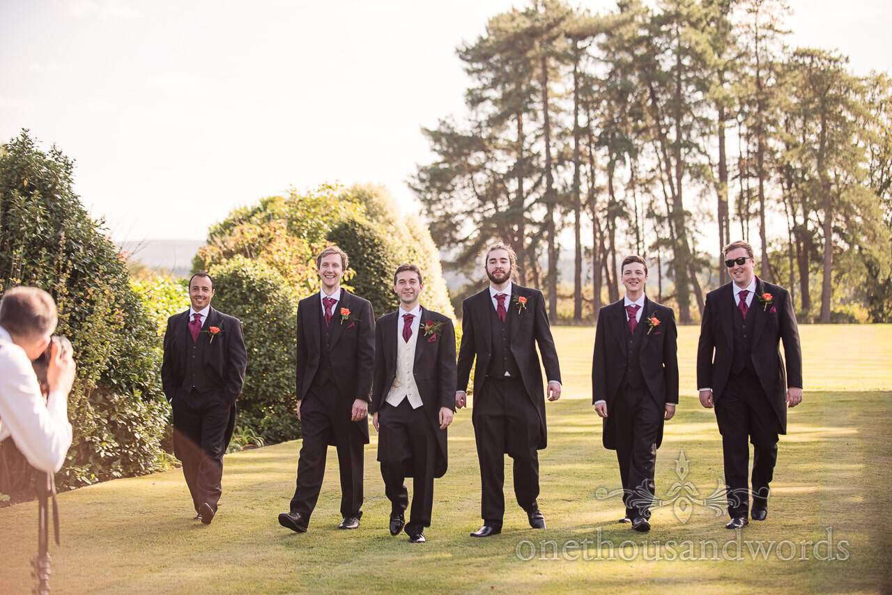 Groomsmen walk for videographer at Hethfelton House Wedding