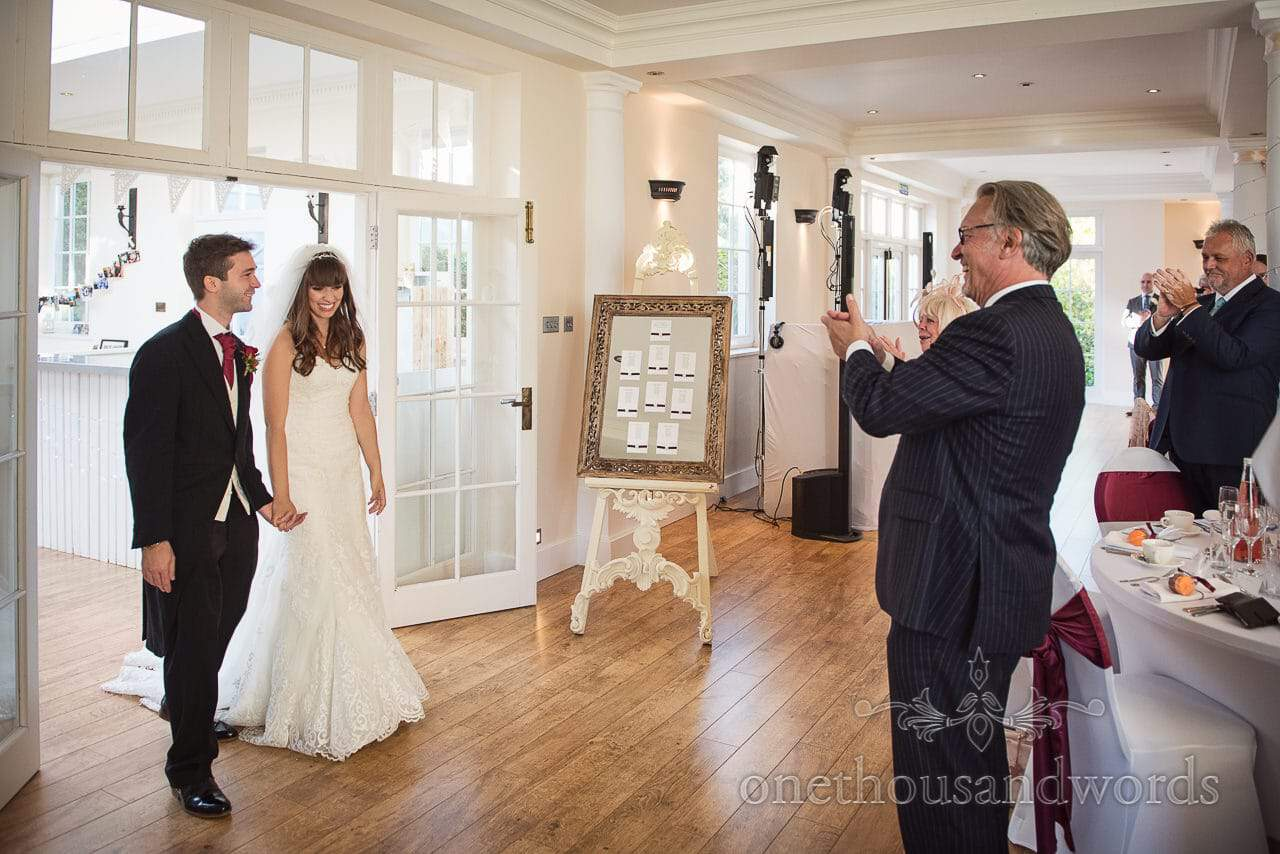 Guest applaud bride and groom arrival at Hethfelton House Wedding