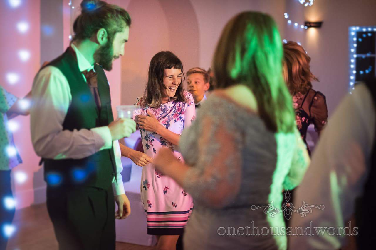 Happy wedding guests dancing at Hethfelton House Wedding venue