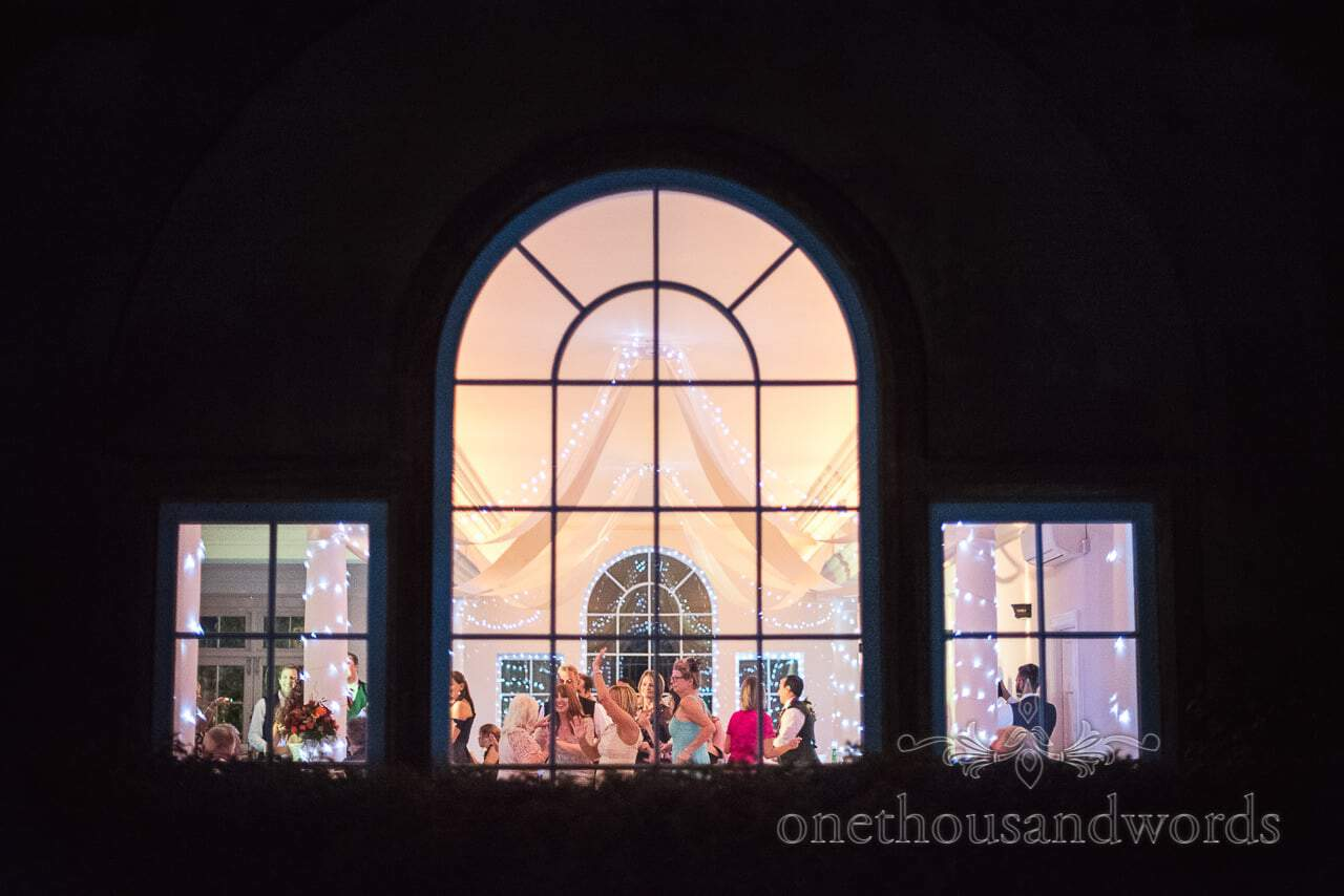 Hethfelton House Wedding dancing photographed through windows