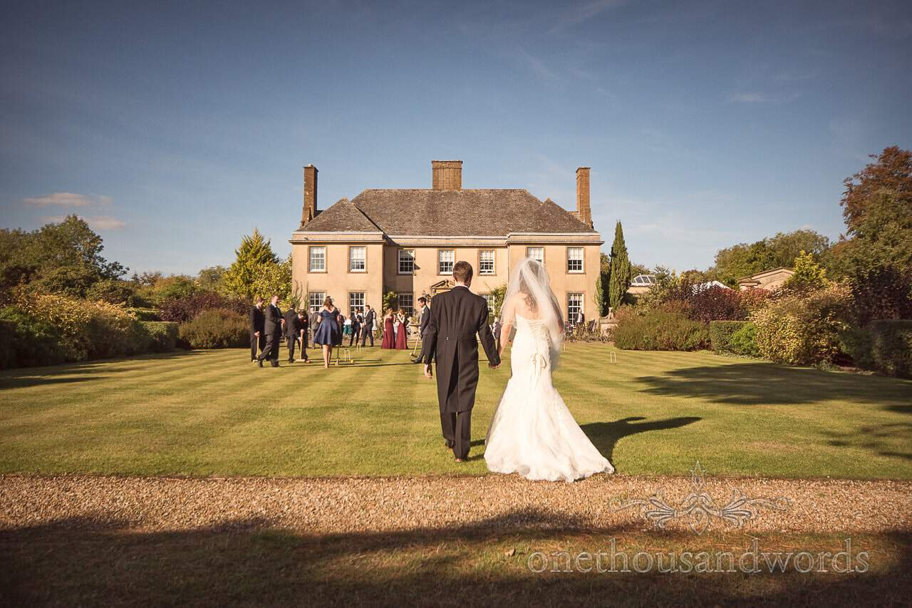 Hethfelton House Wedding Photographs of bride and groom on lawns