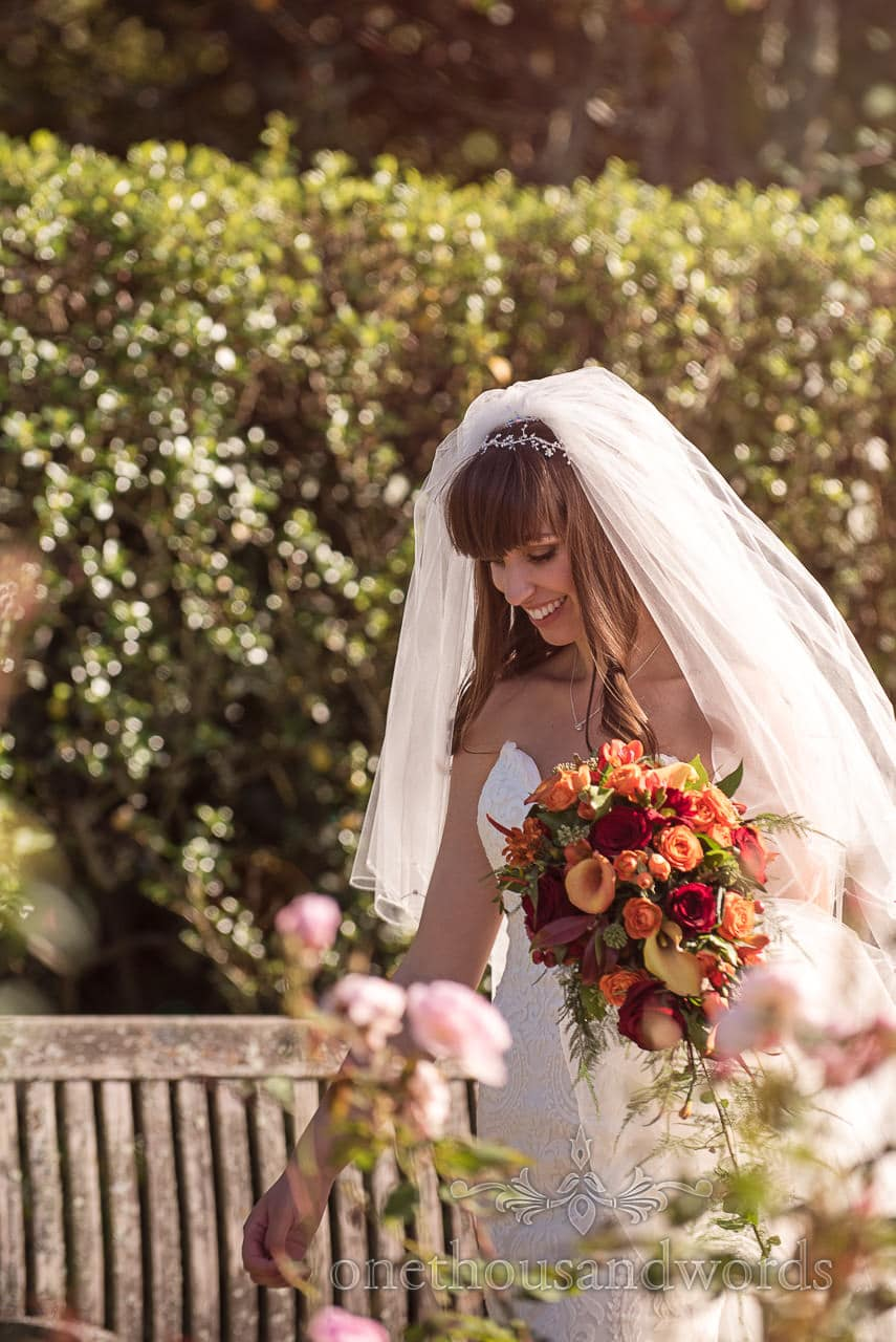 Hethfelton House Wedding Photographs of bride in Rose garden
