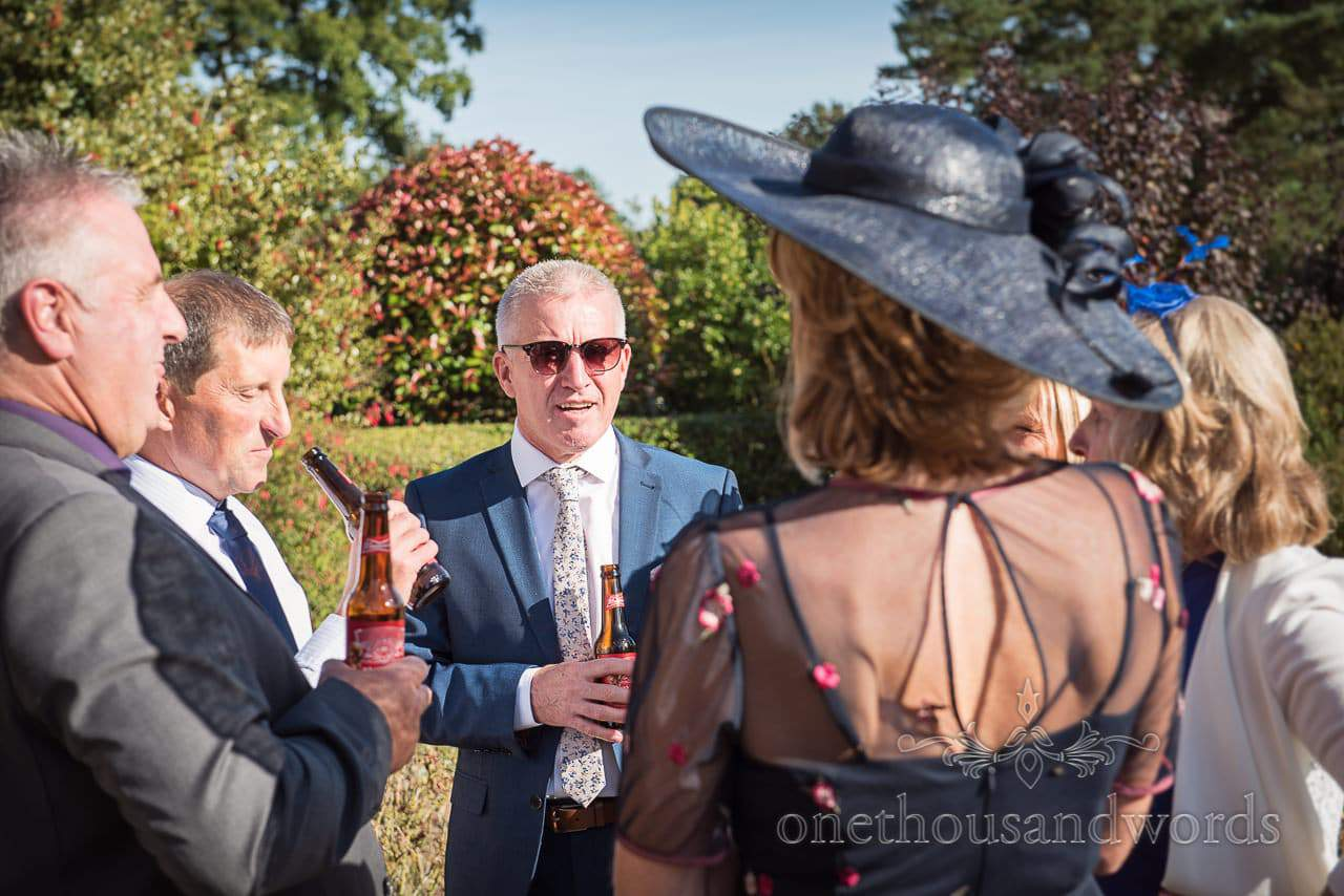 Hethfelton House Wedding Photos of guests enjoying drinks reception