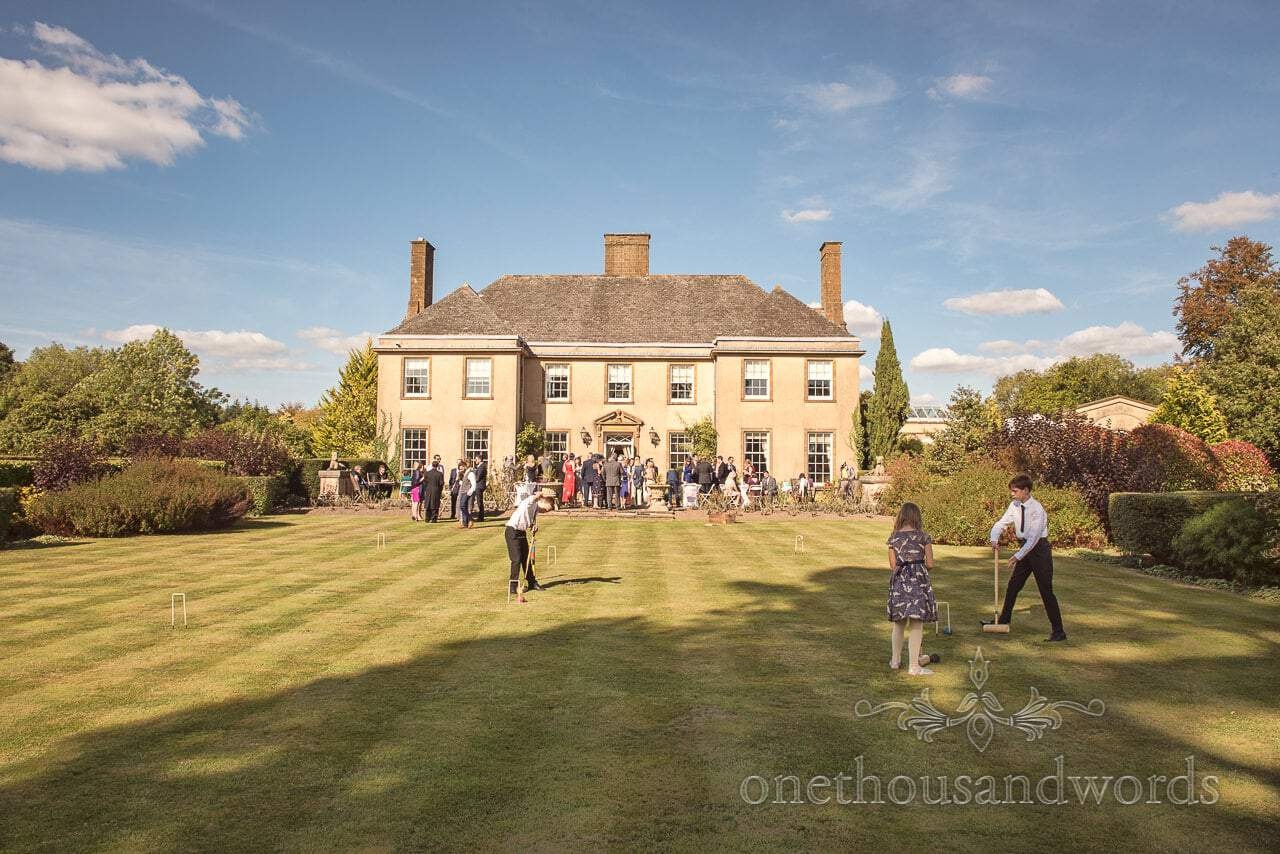 Hethfelton House Wedding venue drinks reception with croquet lawns