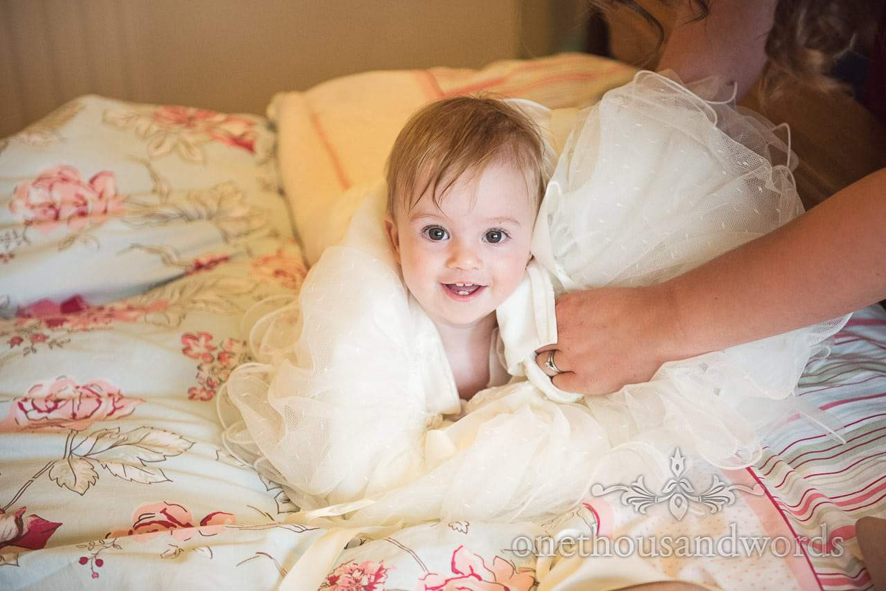 Infant flower girl during morning preparations