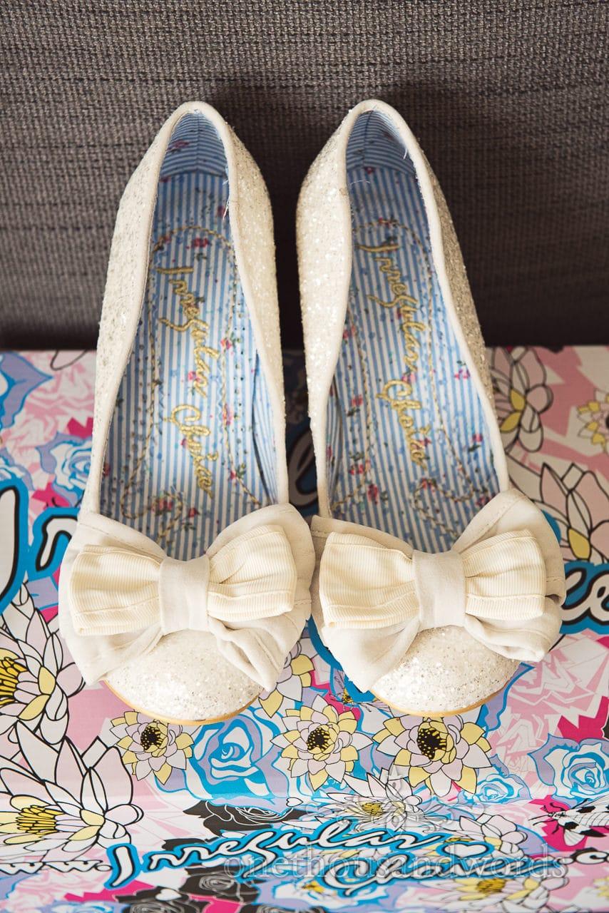 Irregular choice bridal shoes from woodland Lulworth Castle wedding