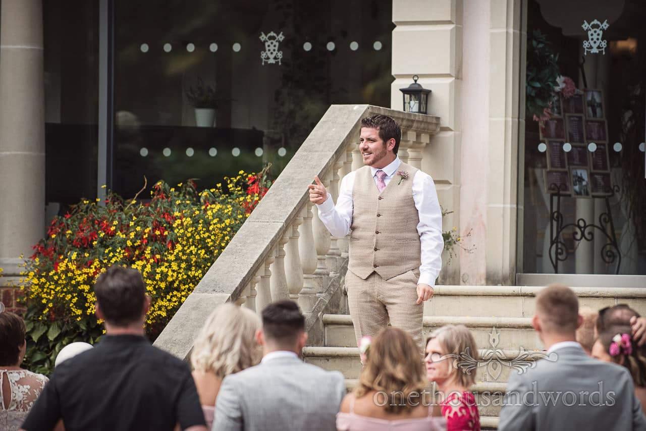 Italian Villa documentary wedding photos of best man instructing guests