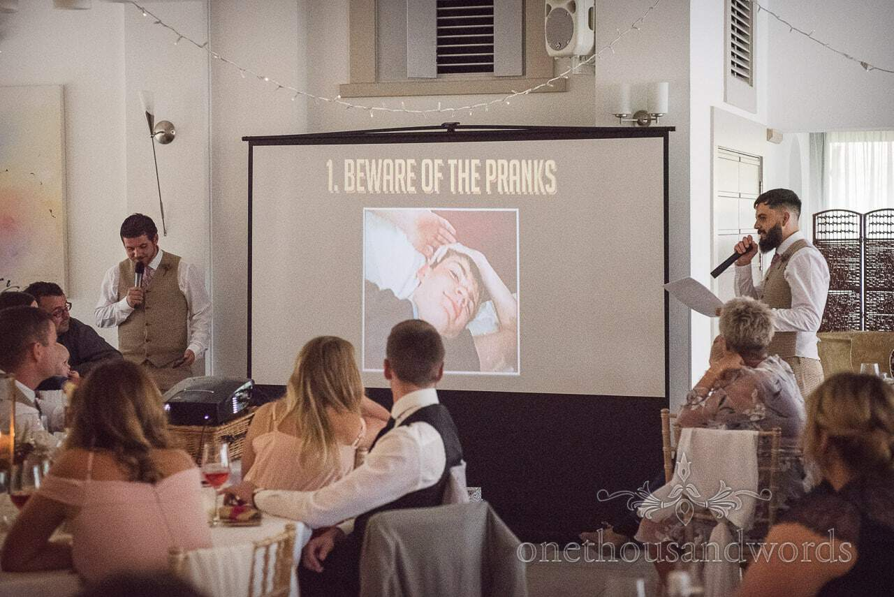 Italian Villa documentary wedding photos of best mens speech with visual aid