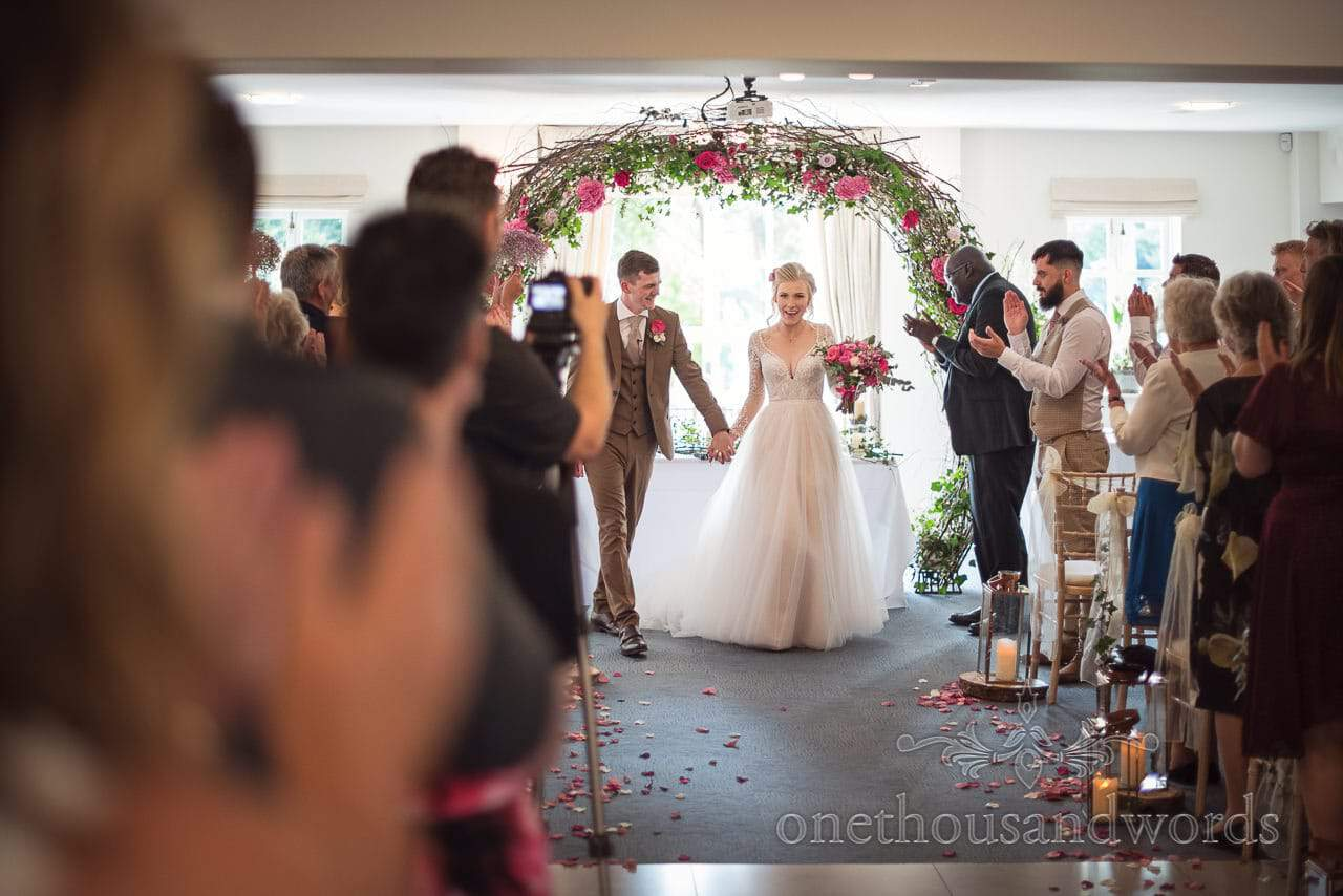 Italian Villa documentary wedding photos of bride and groom, husband and wife come down the aisle