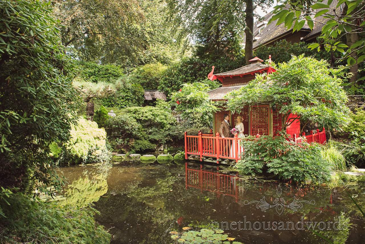 Italian Villa documentary wedding photos of bride and groom in Japanese garden at Compton Acres