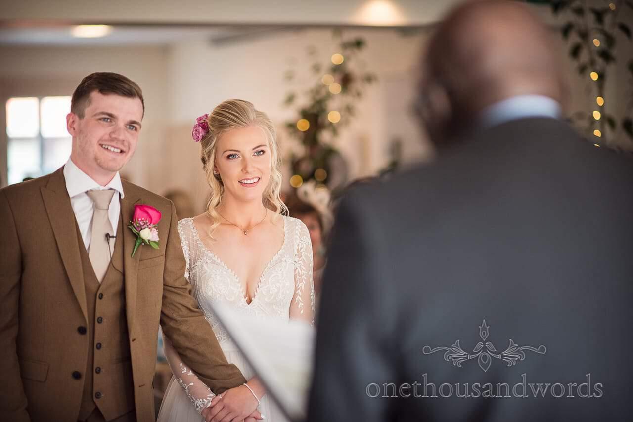 Italian Villa documentary wedding photos of bride and groom listening to registrar