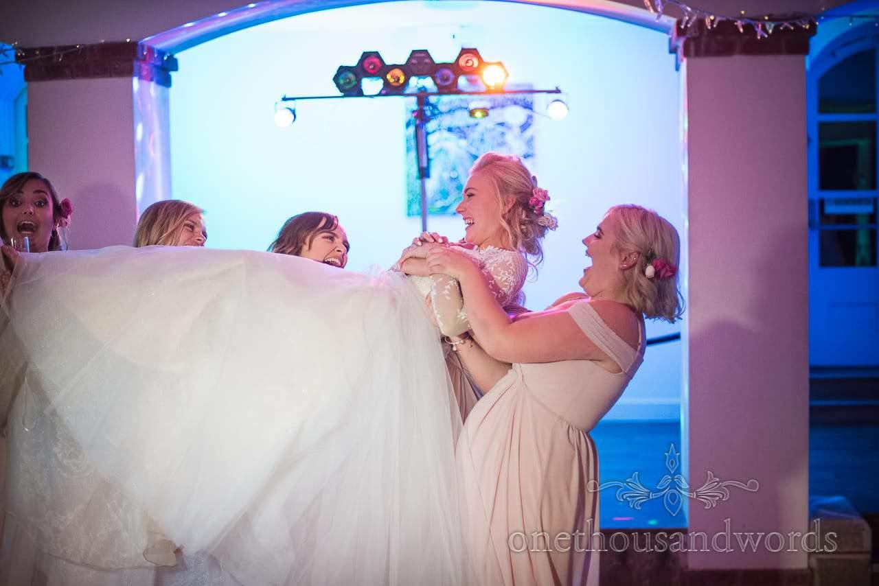 Italian Villa Documentary Wedding Photos of bride lifted by bridesmaids