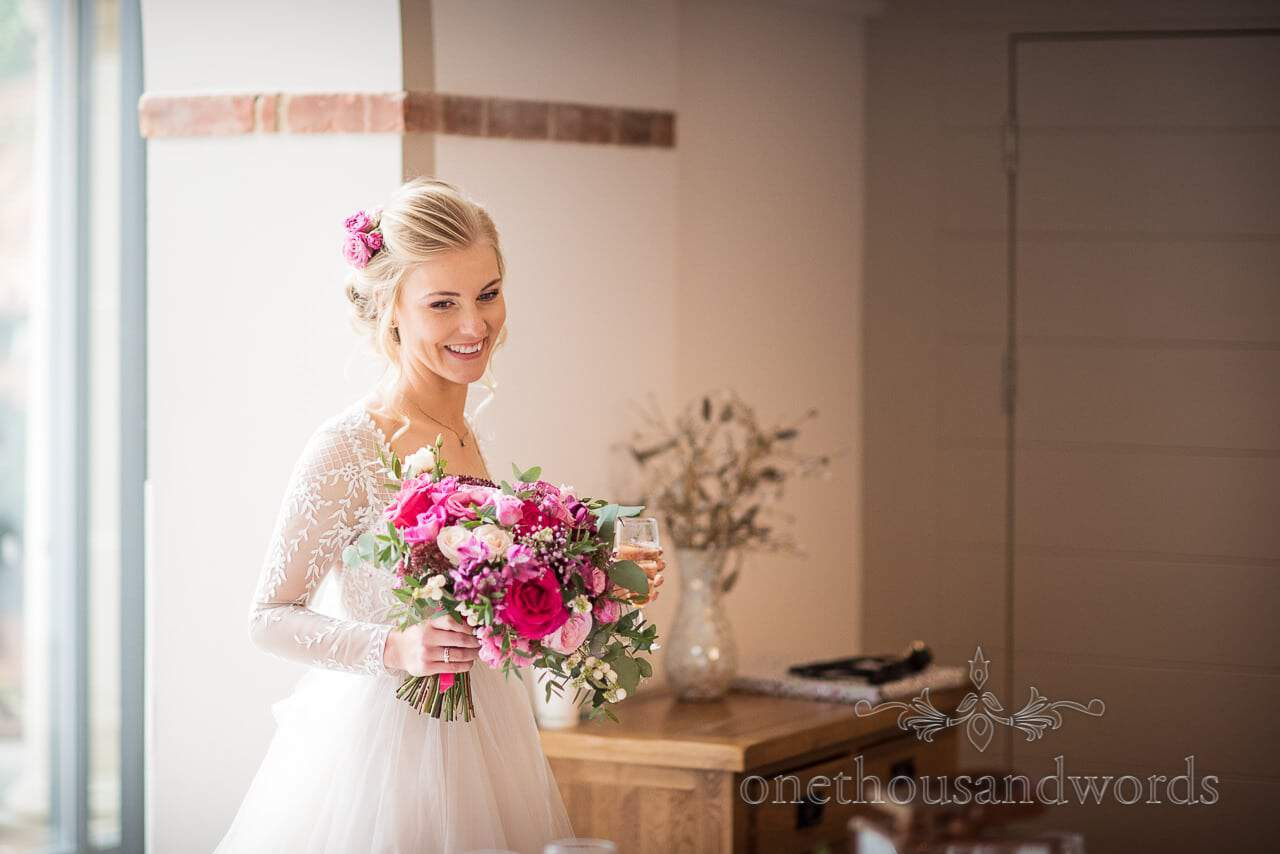 Italian Villa documentary wedding photos of bride with bouquet and bubbles