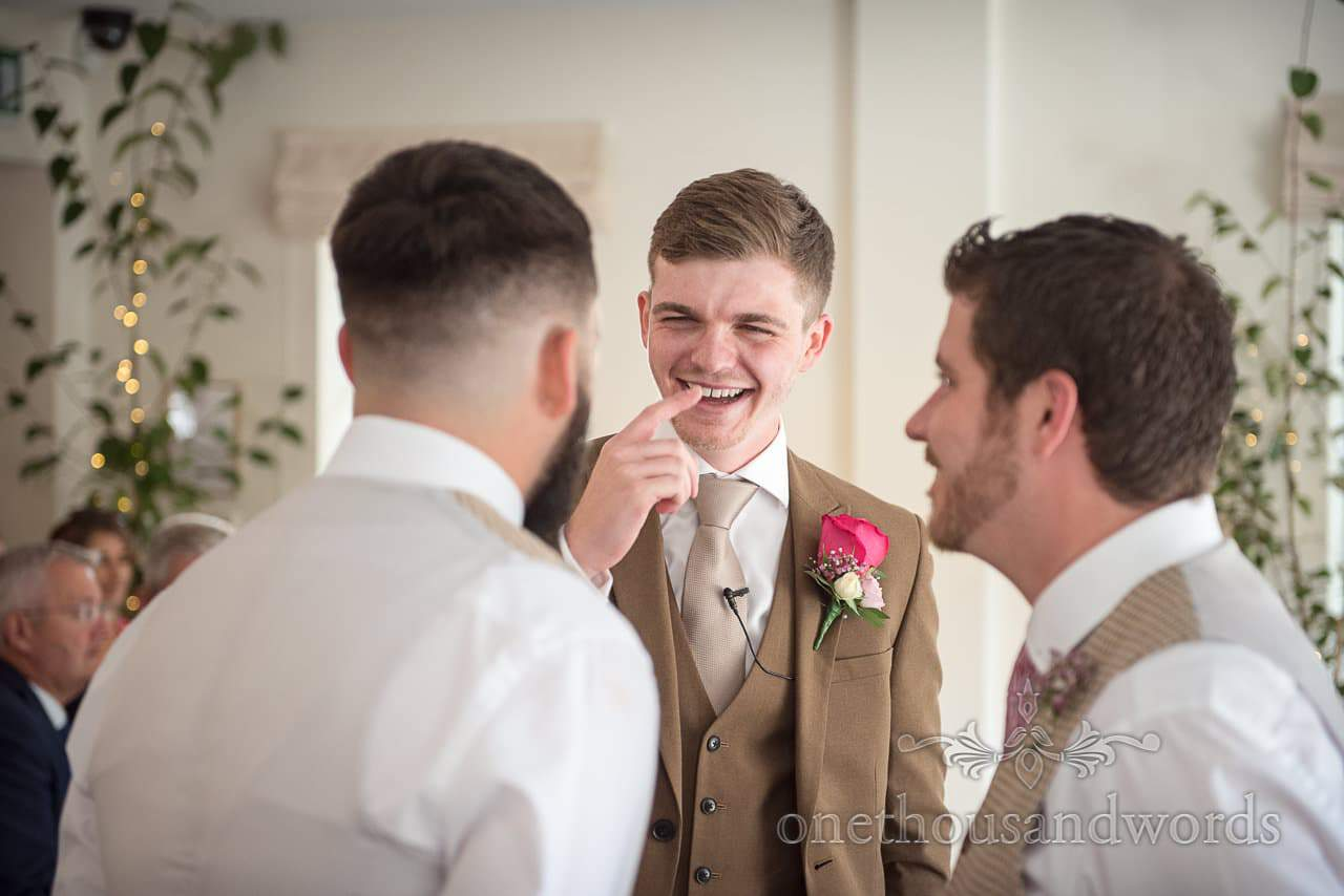 Italian Villa Documentary Wedding Photos of groom sharing joke with best men