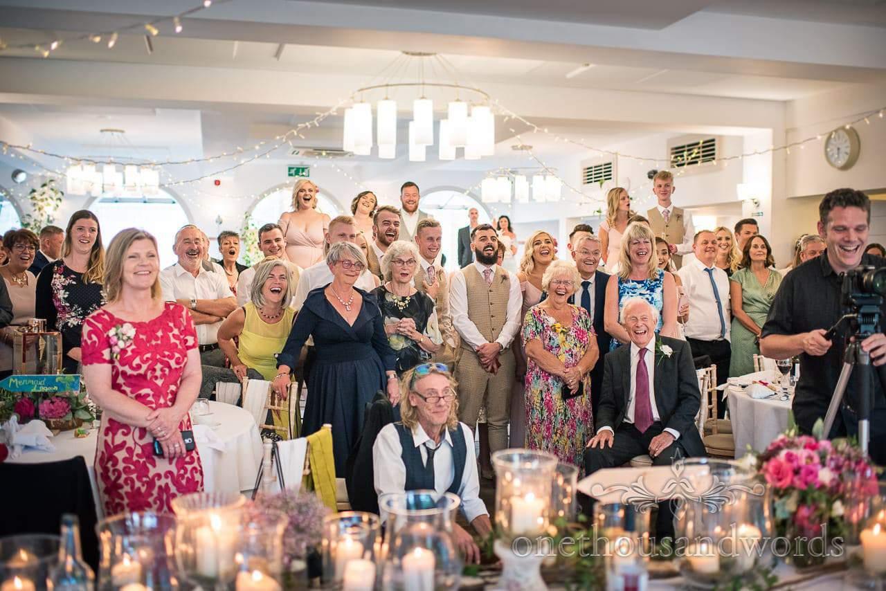 Italian Villa documentary wedding photos of guest reaction to best mans magic