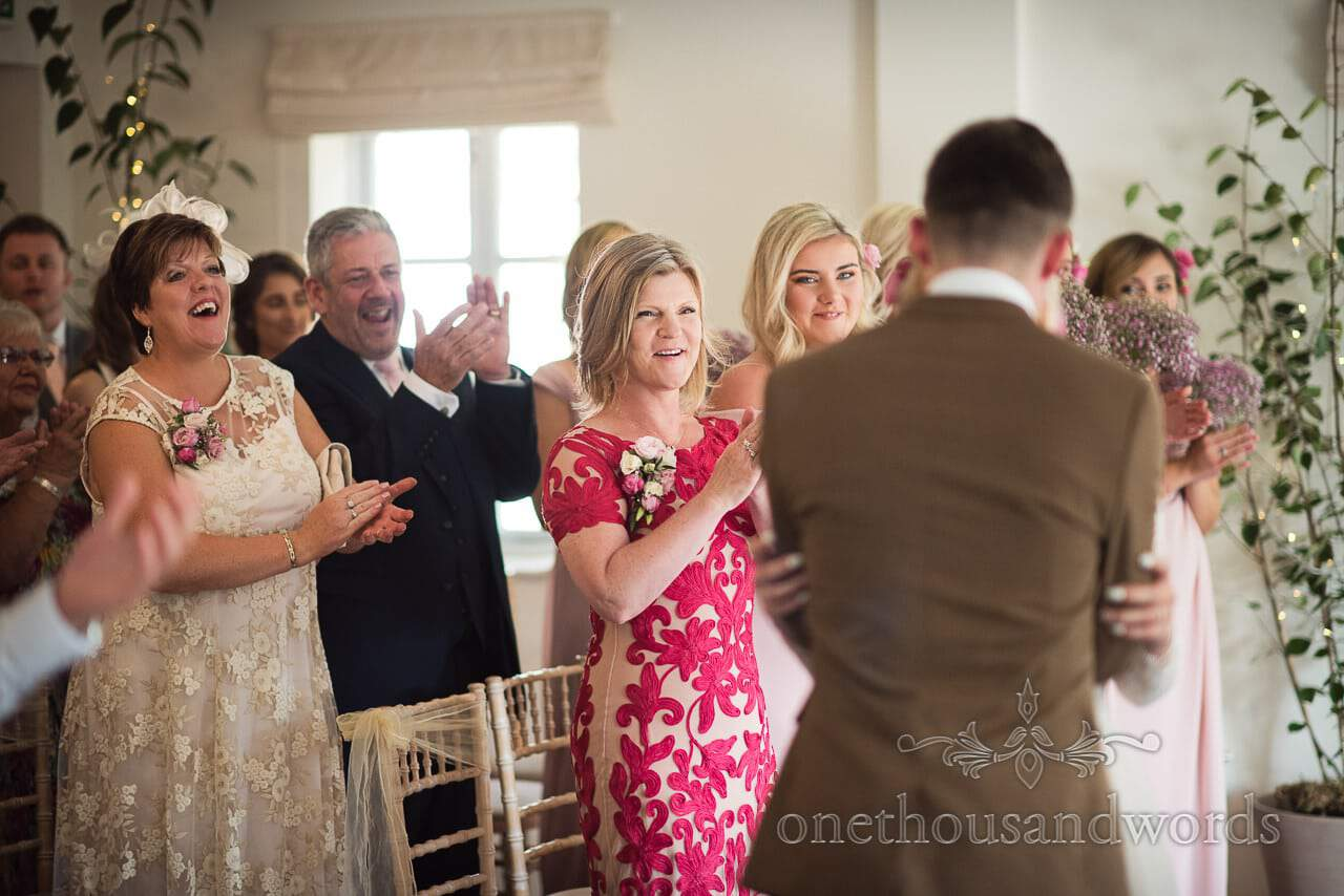 Italian Villa documentary wedding photos of guests applauding during ceremony