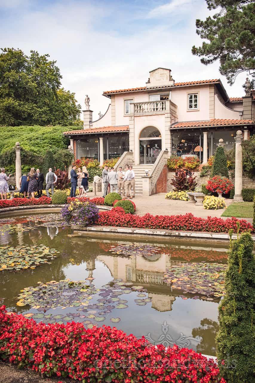 Italian Villa Documentary wedding photos of guests gathering in the garden