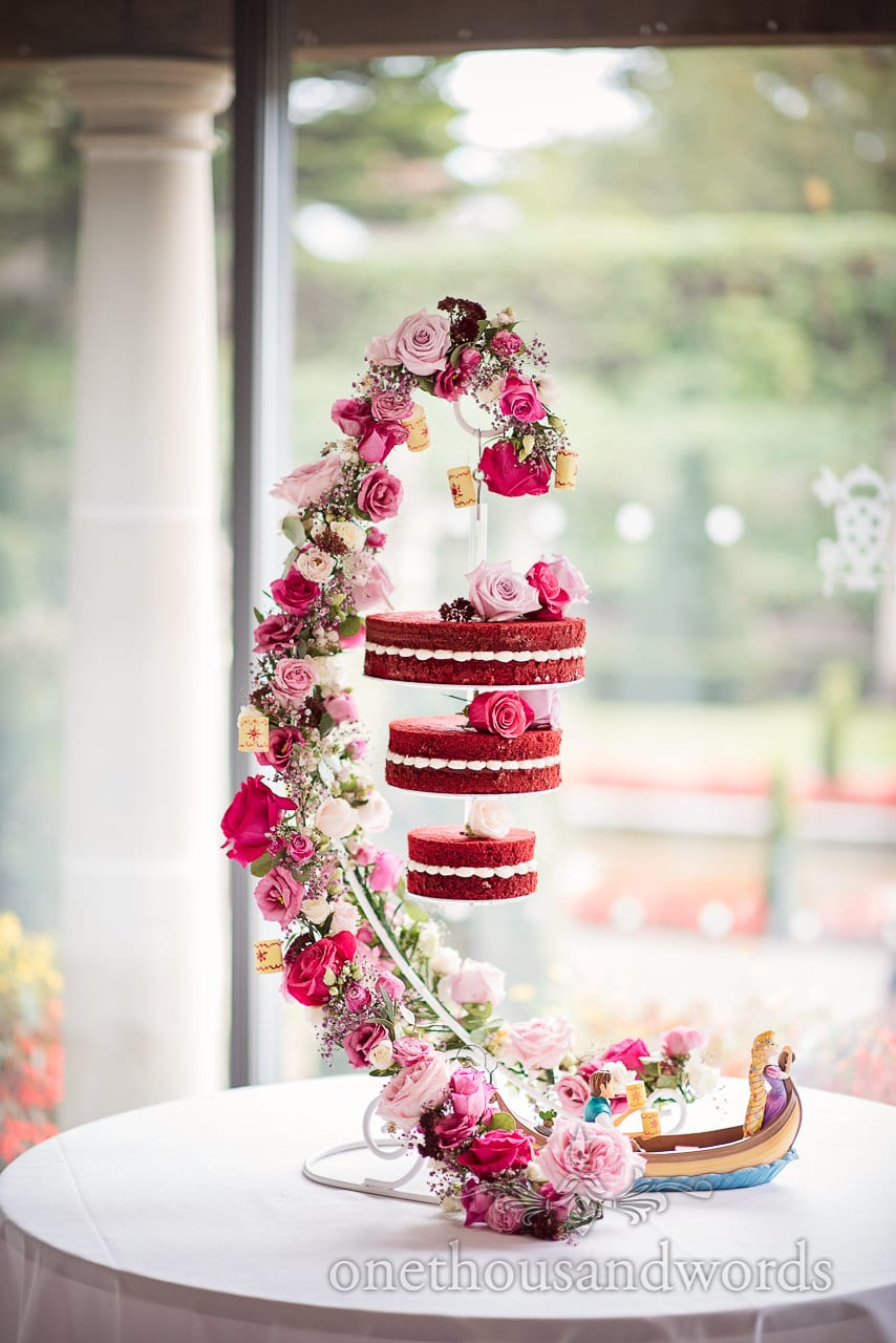 Italian Villa documentary wedding photos of hanging three tier cake