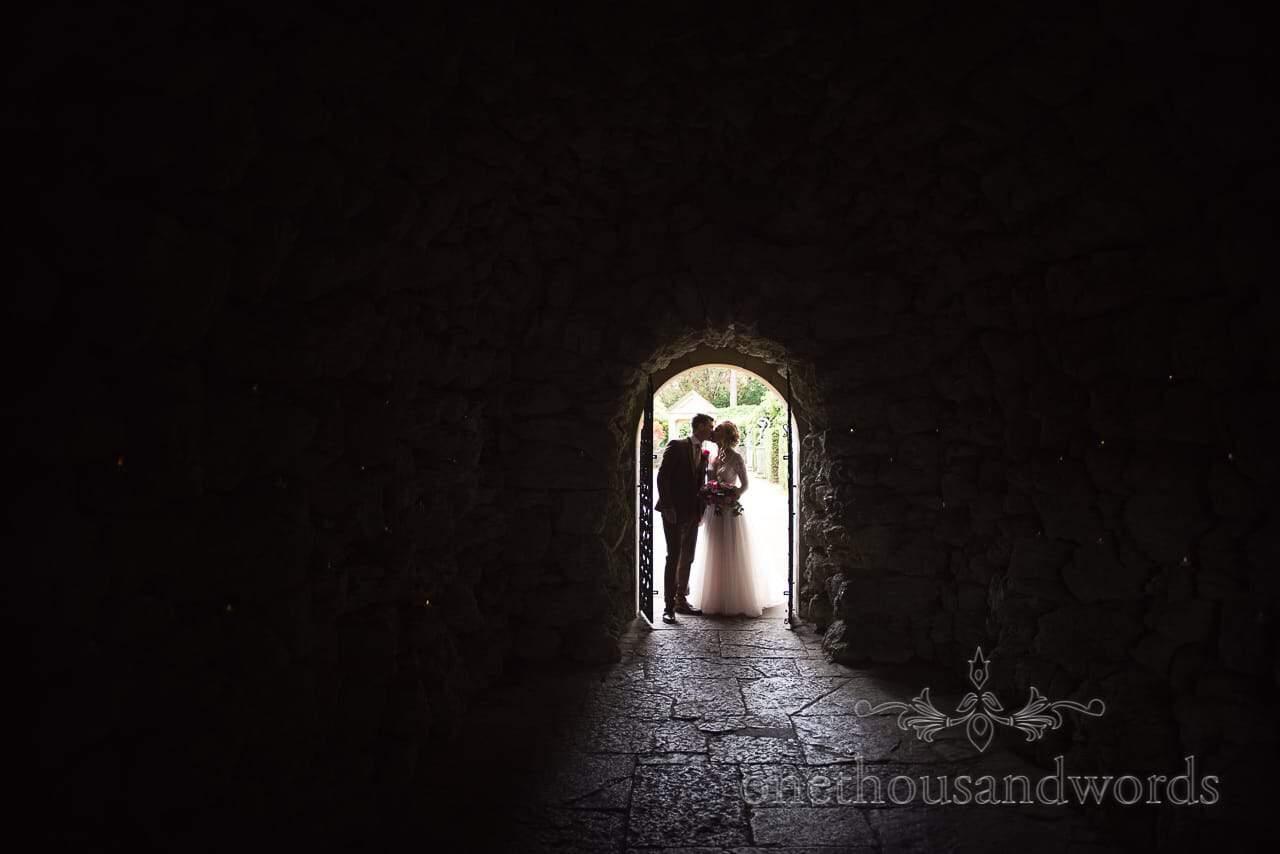Italian Villa documentary wedding photos of kissing couple in doorway
