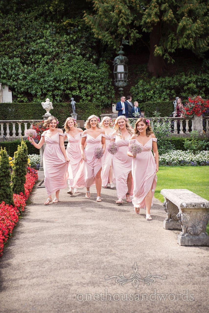 Italian Villa documentary wedding photos of the bridesmaid entering the garden