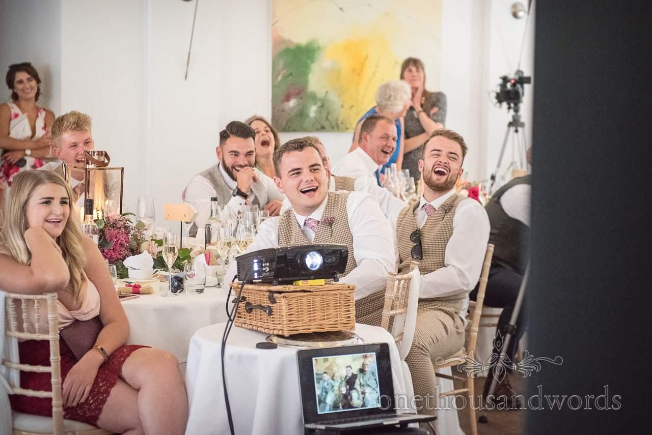 Laughing groomsmen during best mans speech at Italian Villa wedding