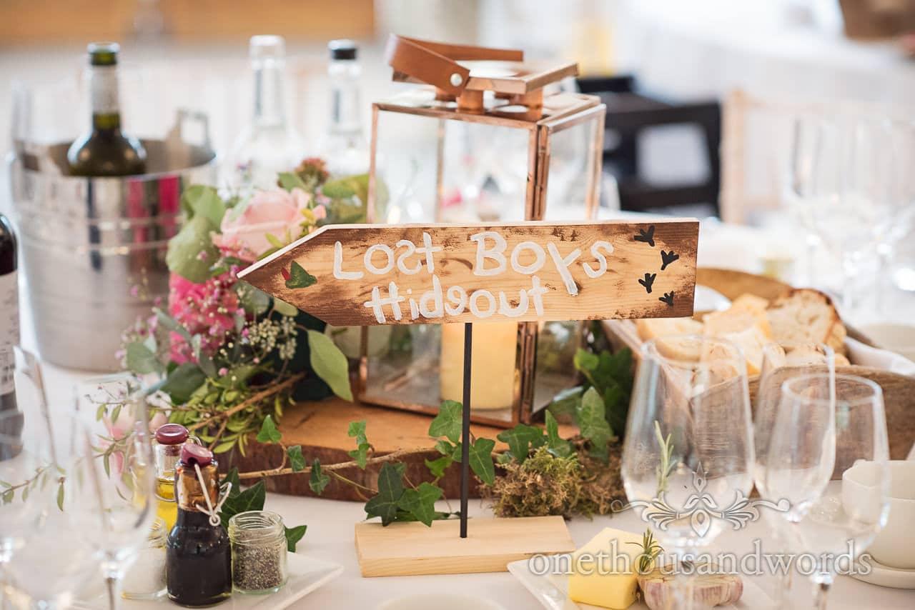 Lost boys theme table sign at Italian Villa wedding