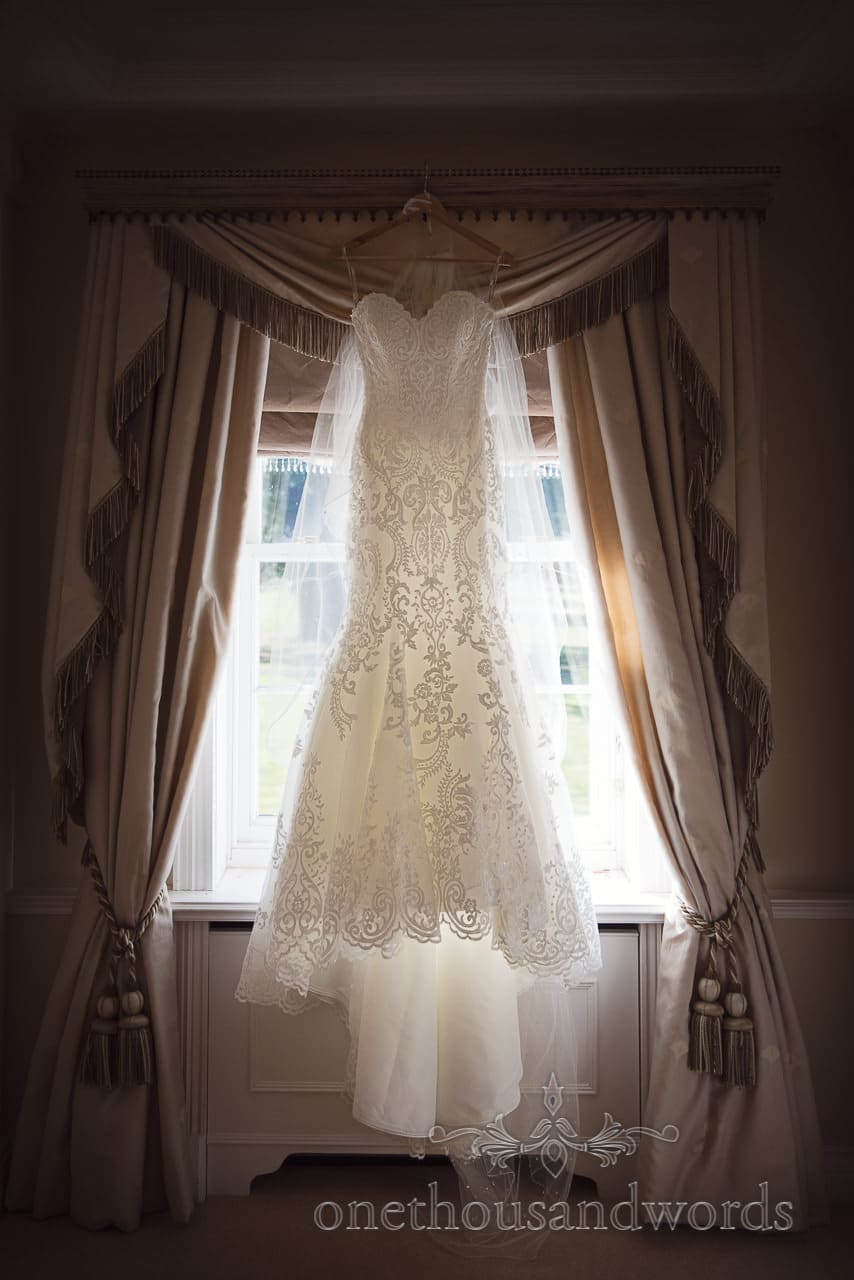 Maggie Sottero A line wedding dress hangs window at Hethfelton House