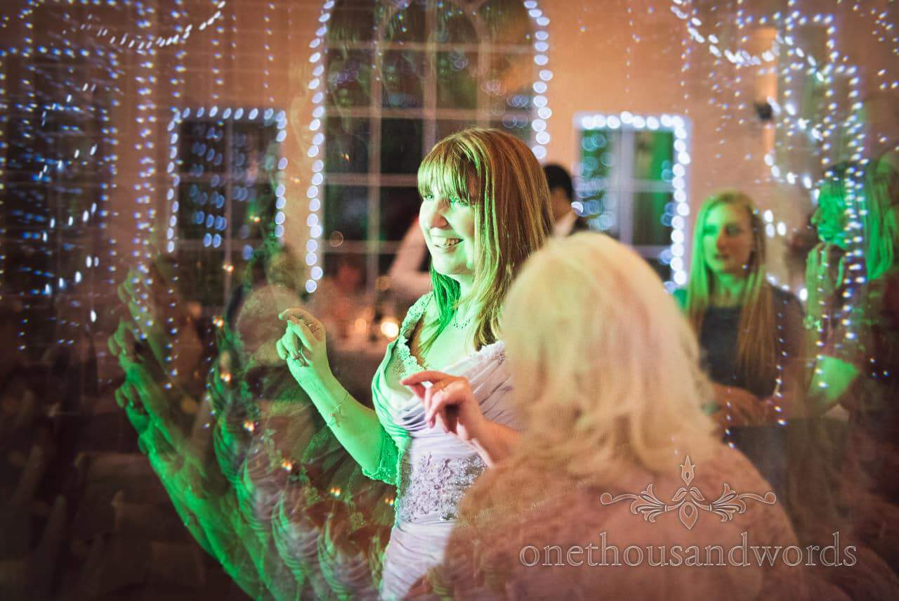 Mother of the bride dancing under lights at Hethfelton House Wedding