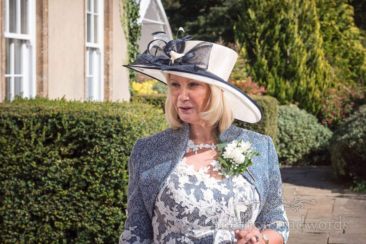 Mother of the groom in blue and white wedding outfit at Hethfelton